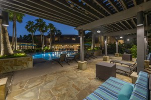 Three Bedroom Apartments for Rent in Northwest Houston, TX -Evening View of Clubhouse, Pergola & Pool Area